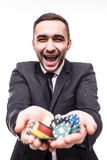 Young man in suit holding up win poker chips.Victory at game Stock Images