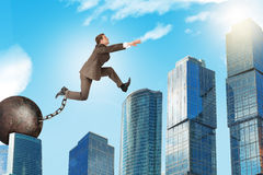 Young man in suit jumping over gap Stock Photos