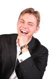 Young man in suit laugh. On a white Stock Photography