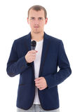 Young man in suit with microphone isolated on white Royalty Free Stock Image