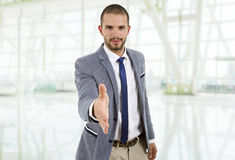 Handshake. Young man in suit offering to shake the hand at the office Stock Photos