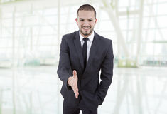 Handshake. Young man in suit offering to shake the hand at the office Stock Photography