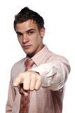 Young man in suit pointing Stock Images