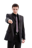 Young man in a suit, points his finger. Young man in a suit, points his finger, isolated on a white background Royalty Free Stock Photography