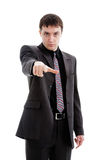 Young man in a suit, points his finger. Young man in a suit, points his finger, isolated on a white background Royalty Free Stock Images
