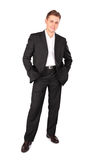 Young man in suit posing Royalty Free Stock Image