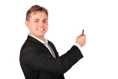 Young man in suit show... Stock Photos