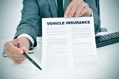 Young man in suit showing a vehicle insurance policy Stock Image