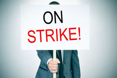 Young man in suit on strike Royalty Free Stock Photo