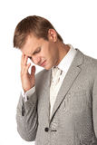 Young man in suit suffering from bad headache Royalty Free Stock Image
