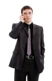 A young man in a suit, talking on the phone. A young man in a suit, talking on the phone, isolated on a white background Royalty Free Stock Photos