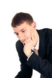 Young man in a suit thinking Royalty Free Stock Photo
