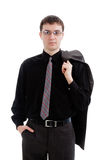 A young man in a suit and tie, holding a jacket. royalty free stock photo