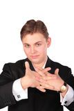 Young man in suit training fingers Royalty Free Stock Photos