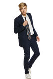 Young man in suit walking Stock Photos