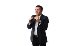 Young man in a suit on a white background showing signs Royalty Free Stock Images