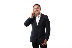 Young man in a suit on a white background talking on the phone Stock Photo
