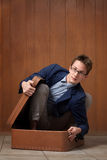 Young Man In Suitcase Royalty Free Stock Photos
