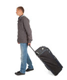Young man with suitcase, full length Stock Photo