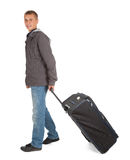 Young man with suitcase, full length Stock Photography