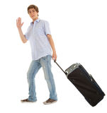 Young man with suitcase waving hello Royalty Free Stock Image
