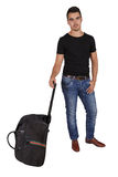 Young man with a suitcase Royalty Free Stock Images