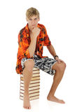 Young man in summer clothes, books Royalty Free Stock Photos