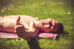 Young man sunbathing Royalty Free Stock Images