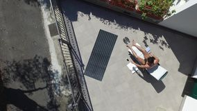 Young Man Sunbathing and Taking Selfie picture stock video