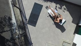 Young Man Sunbathing and Writing on Notepad stock video footage
