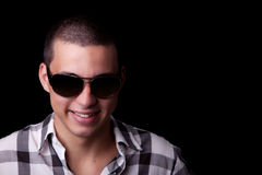 Young Man with Sunglasses. Studio portrait of a young man wearing shades royalty free stock photography