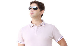 Young man with sunglasses. A portrait of a young man with sunglasses Stock Image