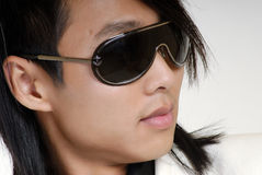 The young man in sunglasses Royalty Free Stock Photography