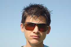 Young man in sunglasses. Portrait of young teenage man in sunglasses royalty free stock images