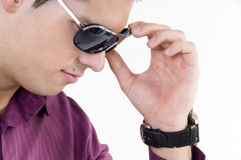 Young man with sunglasses. And watch Royalty Free Stock Photography