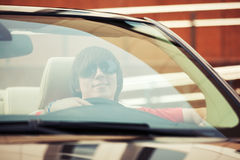 Young man in sunglasses driving convertible car Royalty Free Stock Image