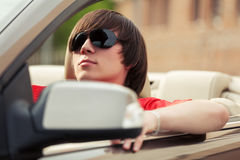 Young man in sunglasses driving convertible car Royalty Free Stock Photo