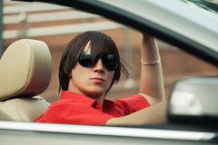 Young man in sunglasses driving convertible car Stock Photo