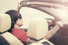 Young man in sunglasses driving convertible car. Young handsome man in sunglasses driving convertible car Stock Images