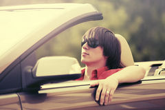 Young man in sunglasses driving convertible car. Young handsome man in sunglasses driving convertible car Royalty Free Stock Image