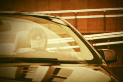 Young man in sunglasses driving convertible car. Young hansome man in sunglasses driving convertible car Royalty Free Stock Images