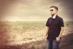 Young man in sunglasses and earphones Royalty Free Stock Photo