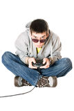 Young man in sunglasses with a joystick Royalty Free Stock Photo
