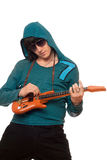 Young man in sunglasses with a little guitar Stock Photography