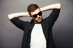 Young man in with sunglasses smiles happily Stock Photography