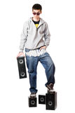 Young man in sunglasses standing on the speakers Royalty Free Stock Photos