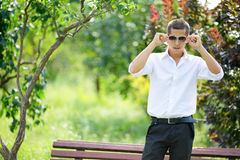 Young man in sunglasses in summer park Royalty Free Stock Images