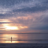 Young man and sunrise on sea. Showing a lonely emotion,hua-hin,thailand Royalty Free Stock Images