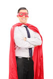 Young man in superhero costume Royalty Free Stock Photography