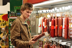 Young man in supermarket Royalty Free Stock Image